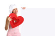 chef woman showing billboard with heart shape