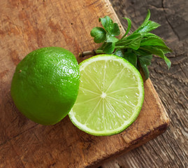 Limes. On a wooden board.