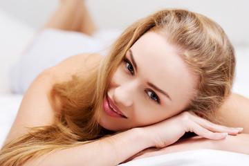 Beautiful girl lying on the bed