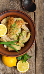 roasted chicken on a plate on a wooden background