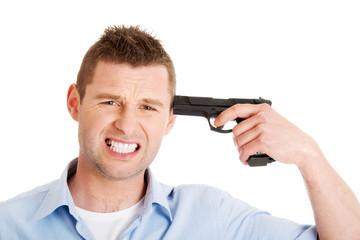 Man with gun making suicide.