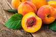 fresh peaches on wood background - 76231145