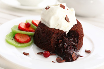Hot chocolate pudding with fondant centre with ice-cream,