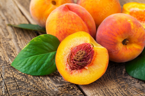 fresh peaches on wood background © zadorozhna