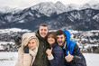 Two beautiful young couple on the background of the Polish Tatra