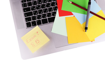 Laptop with sheet of paper and note Exam, on white background