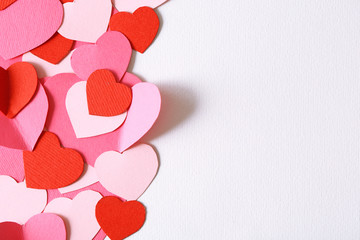 Beautiful hand made post card with hearts and rose petals,