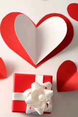Beautiful hand made post card with paper hearts and gift box,