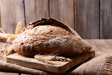 Tasty bread on table on wooden background