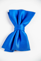 little boy's blue bow tie. Image isolated on white studio backg