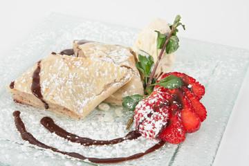 Apple Strudel - sweet dessert on a plate