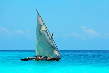 Wooden sailboat (dhow) on water, Zanzibar island