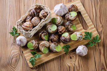 Escargots de Bourgogne, fresh parsley and garlic bulbs