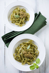 Tagliatelle with basil pesto, view from above, studio shot