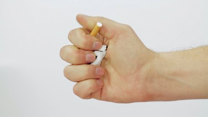 cigarette clamped in his fist