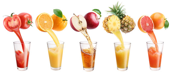 Fresh juice pours from fruits and vegetables in a glass.
