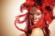 junge Frau mit venezianische Maske