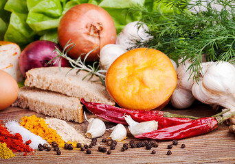 Herbs, Spices and vegetables on wooden table