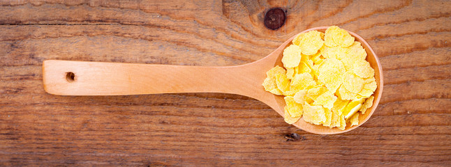 cornflakes in wooden spoon