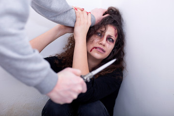 desperate scared and battered women,concept of violence over wom