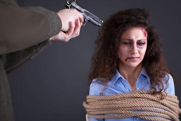 terrorists threatening the a frightened girl with gun