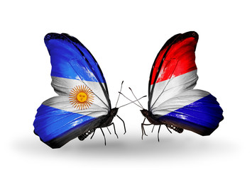 Two butterflies with flags Argentina and Holland