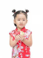Cute asian girl in red chinese dress with heart in hand