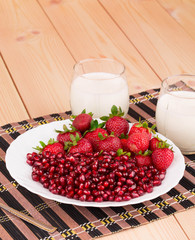 Fresh milk and strawberry isolated on wood.