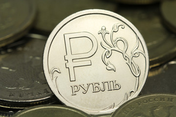one ruble coin in a pile of coins abstract background