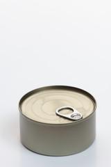 One grey metal can on white background.