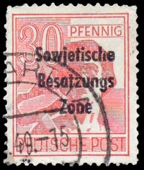 Stamp printed in Germany shows worker with hammer