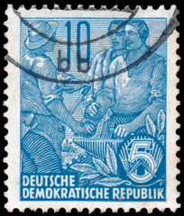 Stamp printed in GDR, shows Farmer and workers