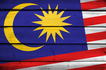 Malaysia Flag on wood background