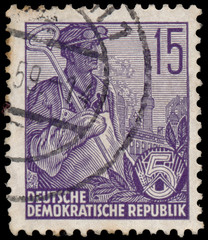 Stamp printed in GDR, shows worker