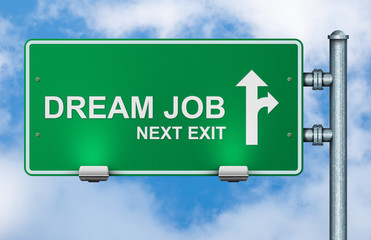 Dream job next exit road sign on sky background.
