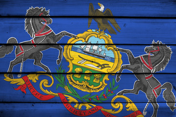 Pennsylvania State Flag on wood background