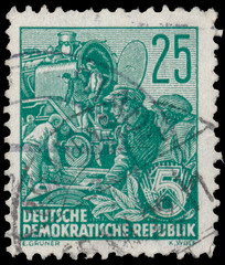 Stamp printed in GDR shows Reconstruction of steam locomotive