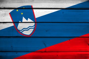Slovenia Flag on wood background