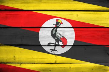 Uganda Flag on wood background