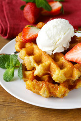 Belgian waffles with berries and ice cream