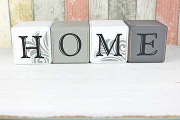 Home sign on a distressed wood background