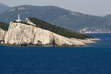 A lighthouse on the coast of Greek island.