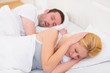 canvas print picture - Young woman can't sleep because of boyfriend's snoring