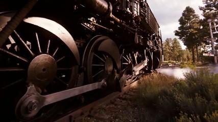 Steam train rides on rails
