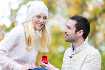 Young attractive man propose marriage to his love