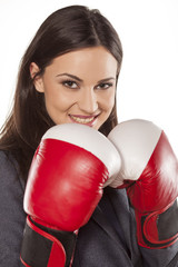 happy business woman with boxing gloves on a white background