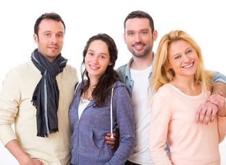 Group of 4 young attractive people on a white background