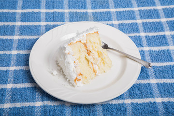 Delicious Coconut Cake on Blue Towel