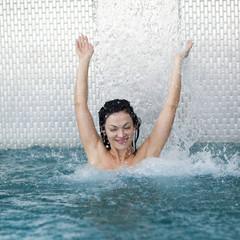 spa hydrotherapy woman waterfall jet turquoise swimming pool wat