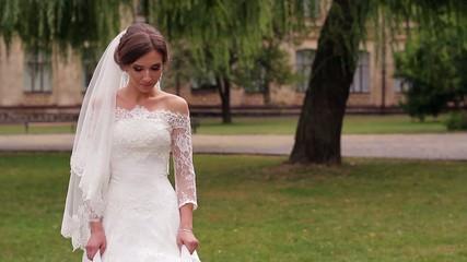 bride in  white dress makes a decision